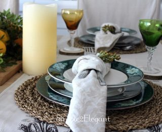 Simple Autumn table setting with natural foliage